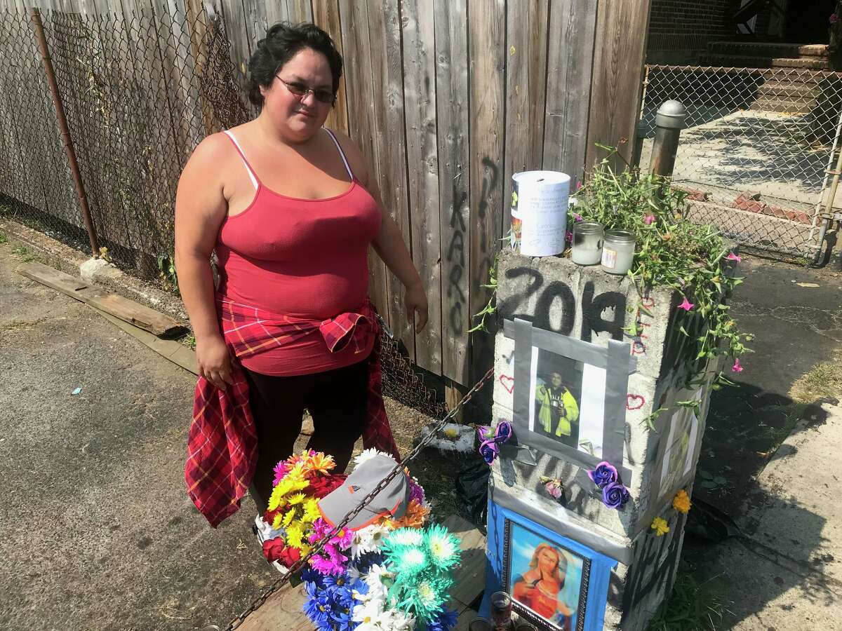 Linda Soto, 28, standing next to the memorial to Leobardo Quintero, 43, who died after being pushed to the ground during an argument on lower Alden Street last week.