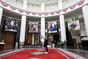 An attendee takes photos at the George H.W. Bush Library and Museum at College Station, Texas on Saturday, Dec. 1, 2018.
