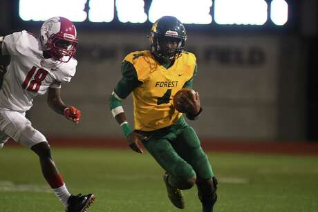 Klein Forest senior quarterback Myles Rhodes (4) runs away from Cy Lakes junior defensive back Day'shan Hall (18) on a running play in the 4th quarter of their matchup at Klein Memorial Stadium on Sept. 5, 2019.