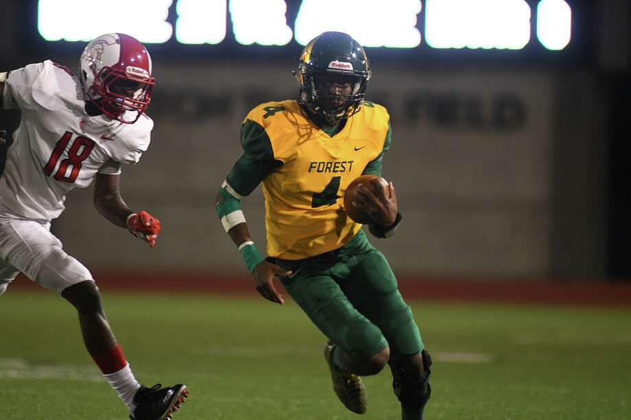 Klein Forest senior quarterback Myles Rhodes (4) runs away from Cy Lakes junior defensive back Day'shan Hall (18) on a running play in the 4th quarter of their matchup at Klein Memorial Stadium on Sept. 5, 2019. Photo: Jerry Baker, Houston Chronicle / Contributor / Houston Chronicle