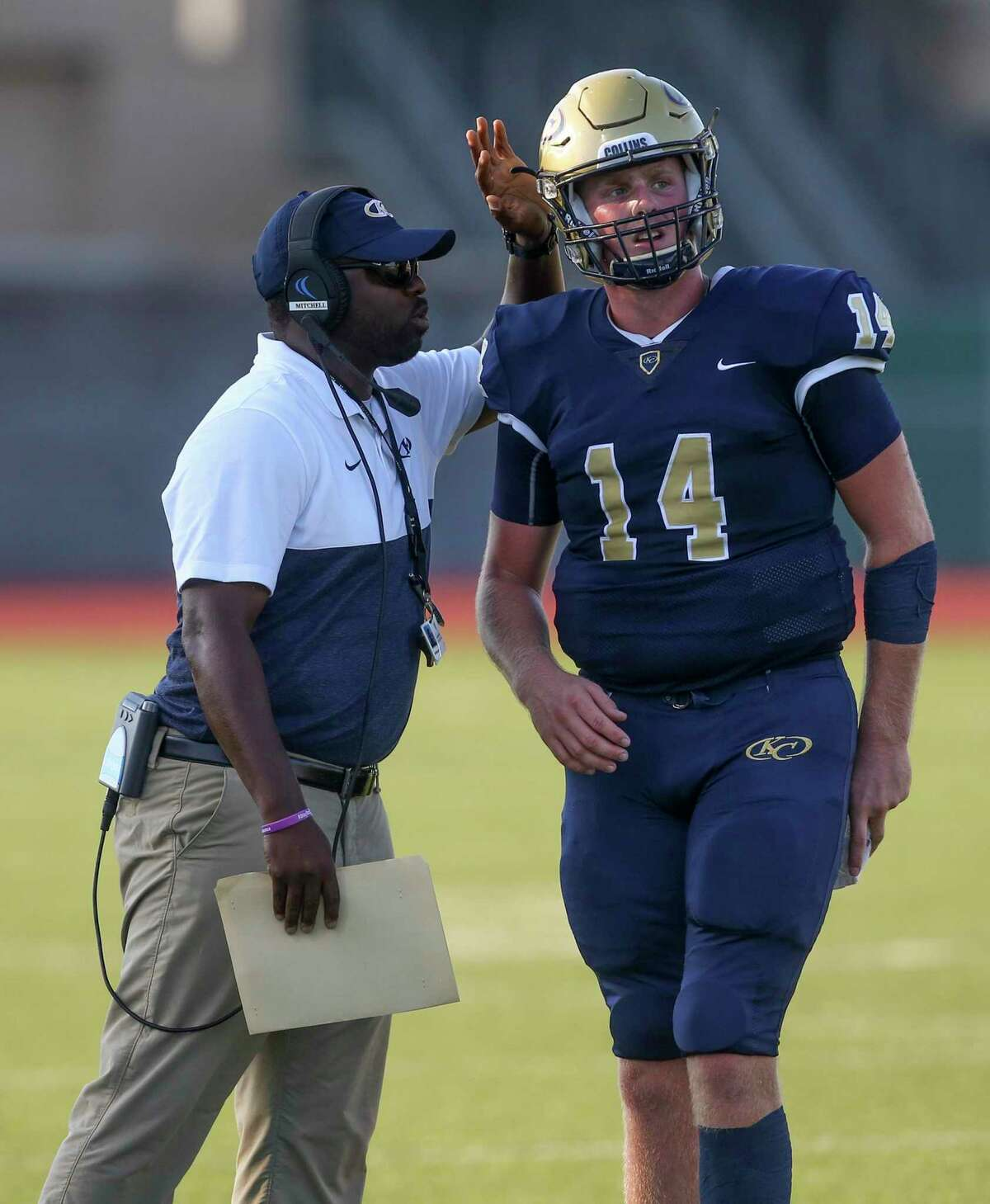 Klein Collins head football coach Adrian Mitchell talks to quarterback Colby Powers (14) while playing against Clear Springs in the second quarter at Memorial Stadium on September 7, 2019 in Spring, TX.