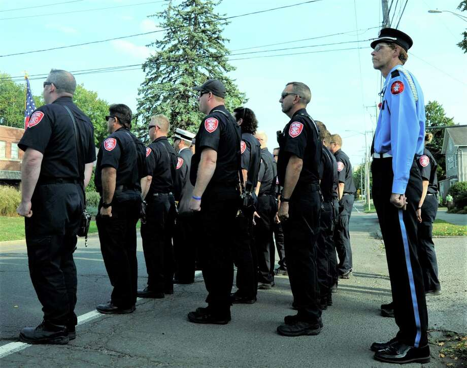 Danbury Fire Department members stand at attention during the annual September 11 Remembrance program in downtown Danbury on Wednesday. Photo: Hearst Connecticut Media