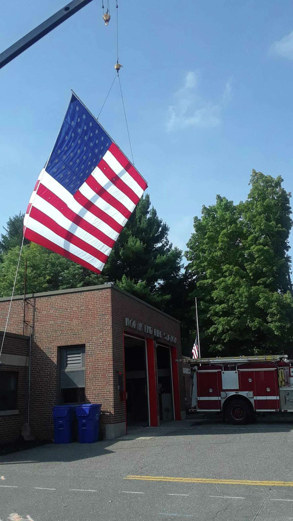Torrington Fire Department hung a huge American flag over the North End Fire Station in honor of 9/11 on Wednesday, and held a ceremony in the morning.