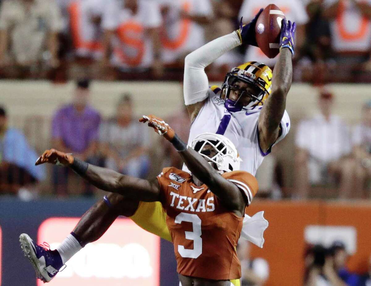 Texas defensive back Jalen Green (3) is unable to prevent a completion to LSU's Ja'Marr Chase in the Longhorns' 45-38 loss to the Tigers.