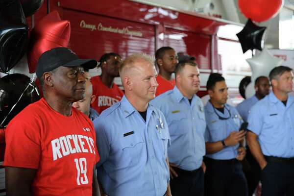 Calvin Murphy and other Rockets visited all 94 Houston-area fire and police stations on Wednesday as a show of thanks.