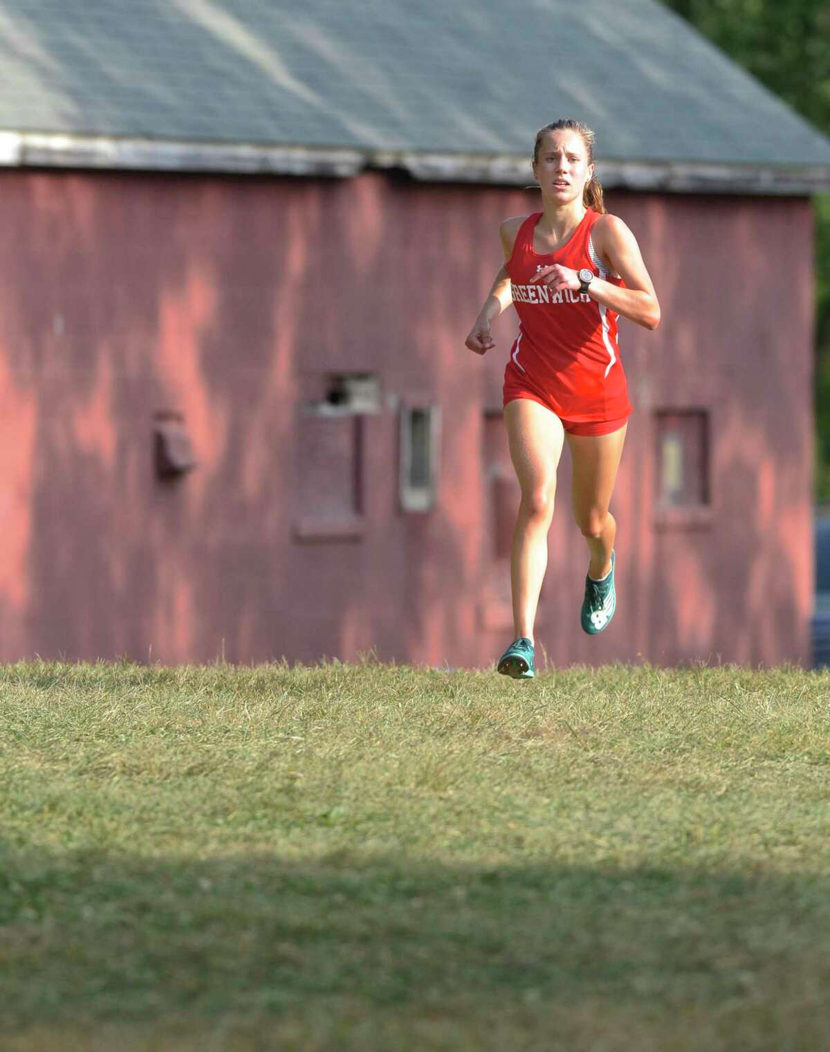 Mari Noble, from Greenwich HS, finished first in the girls Cross Country meet between Fairfield Ludlowe, Greenwich, Norwalk and Danbury high schools, Wednesday, September 11, 2019, at Tarrywile Park, Danbury, Conn.