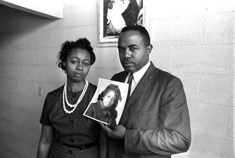 Chris McNair and his wife, Maxine, hold a photograph of their daughter Denise the day after she was killed in the Sept. 15, 1963 bombing of Sixteenth Street Baptist Church in Birmingham, Ala.