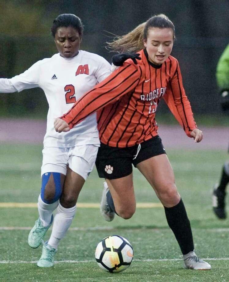 Ridgefield's Faith Arnold had 13 goals and eight assists last season. Photo: Scott Mullin / For Hearst Connecticut Media / The News-Times Freelance