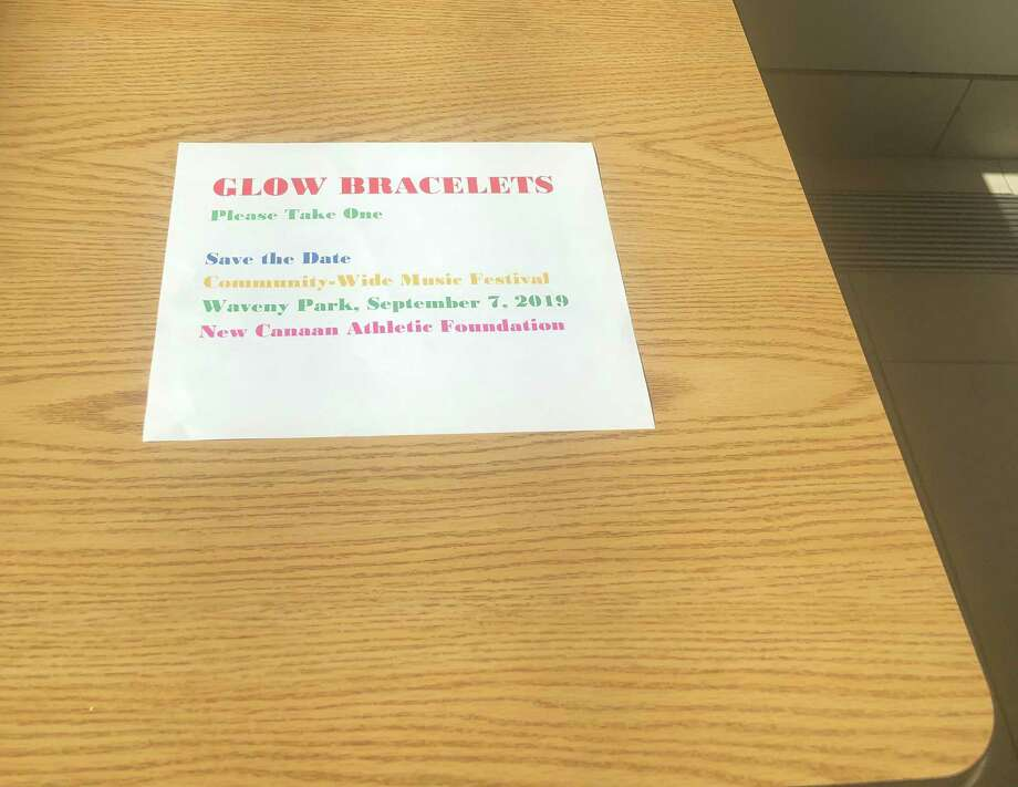 The loop athletic bracelets that glow in the dark, and which were on the folding table on your right as you walk into New Canaan Town Hall prior to the first annual Town concert at Coppo Field in Waveny Park this past Saturday, Sept. 7, 2019, were all gone after the event Monday, Sept. 9, 2019, a true sign that the festival is popular, especially after its first year. Just a flyer remained on Monday, and representation of a time well had. Contributed photo Photo: Contributed Photo