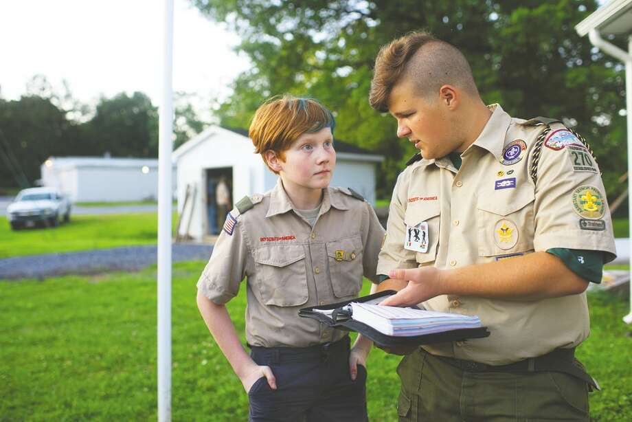 Aidan Johnson, left, 12, and Charlie Farkas, 14, a troop leader, at one of Troop 270's weekly meetings last month in Thurmont, Md. Photo: Washington Post Photo By Marvin Joseph