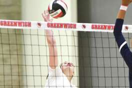 Greenwich's Lily Saleeby hits a shot durin ga match against Staples last season.