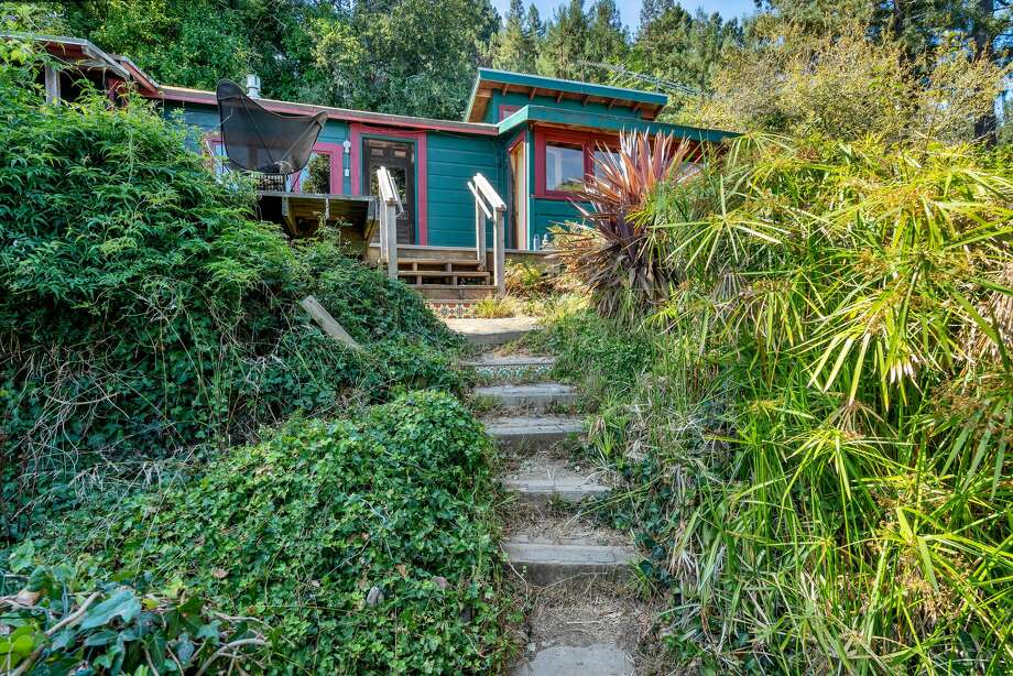 Circa 1918, this tiny cabin in the treetops with killer Mt. Tam and bay views wants 599K Photo: Adam Potts