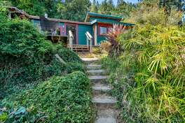 Circa 1918, this tiny cabin in the treetops with killer Mt. Tam and bay views wants 599K