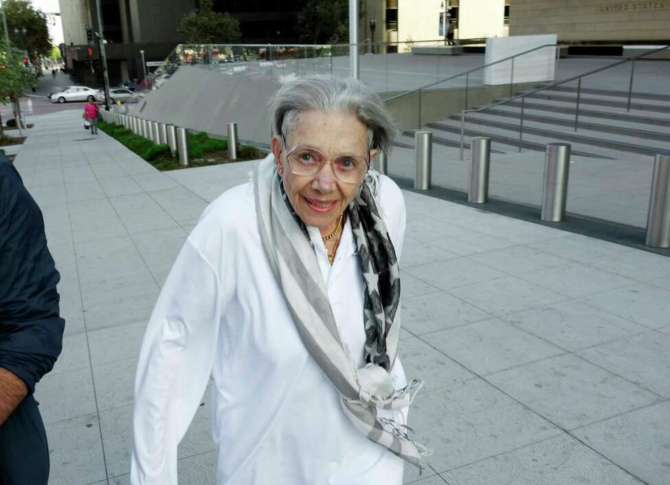 FILE - In this Aug. 29, 2017, file photo, Waverly Scott Kaffaga, stepdaughter of author John Steinbeck, leaves federal court in downtown Los Angeles. A federal appeals court has thrown out $8 million in punitive damages against the daughter-in-law of author John Steinbeck in her long-running copyright spat with the late author's step-daughter. The 9th U.S. Circuit Court of Appeals on Monday, Sept. 9, 2019, upheld a $5 million verdict against Gail Steinbeck and told her it's time to end her legal saga. Kaffaga, whose mother Elaine was married to Steinbeck when he died in 1968, won a lawsuit two years ago showing Gail Steinbeck meddled with plans to make money off his most famous works. (AP Photo/Brian Melley, File)