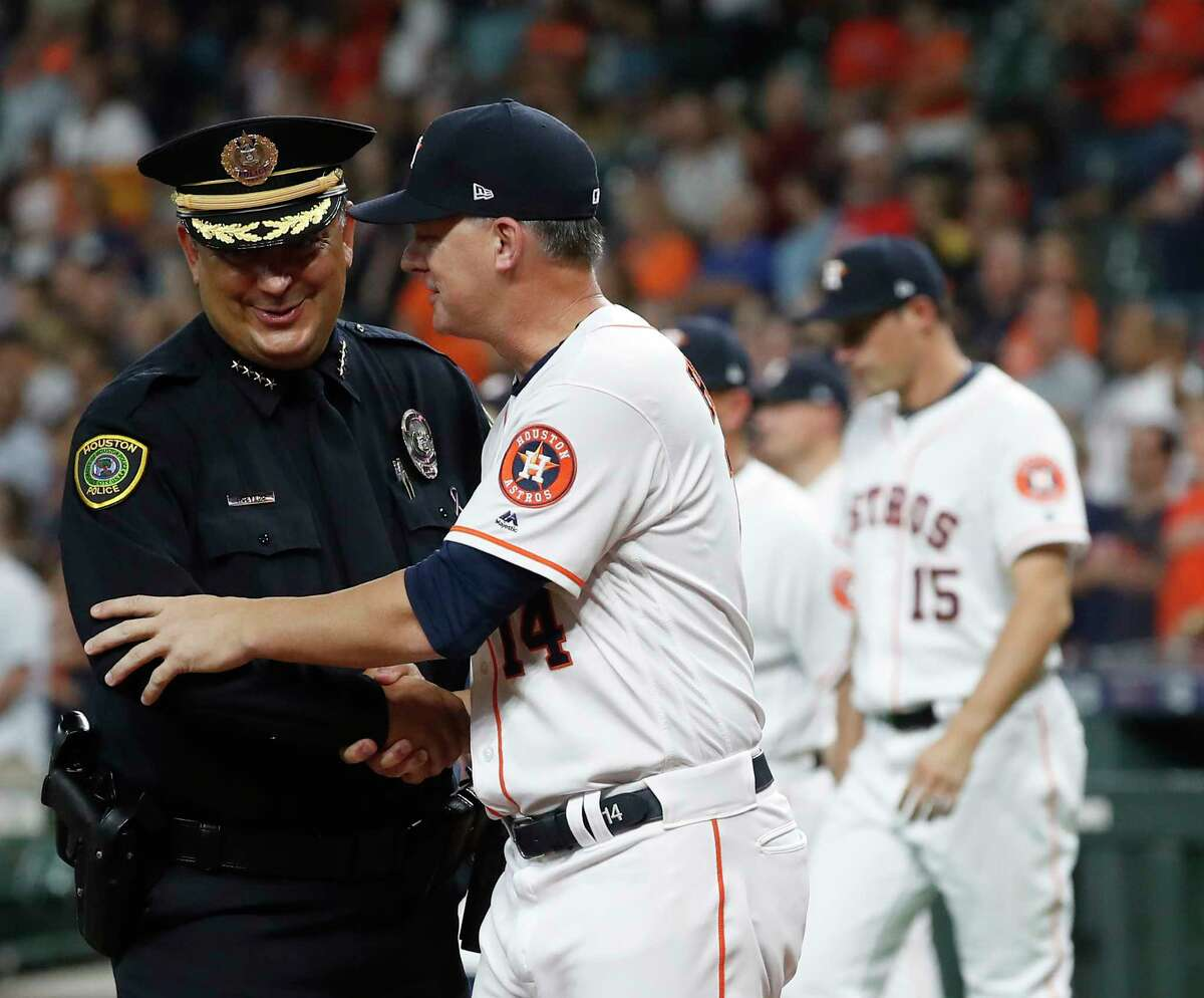 Houston Astros manager AJ Hinch (14) greets Houston Police Chief Art Acevedo before the start of the first inning of a MLB baseball game at Minute Maid Park, Wednesday, Sept. 11, 2019, in Houston.