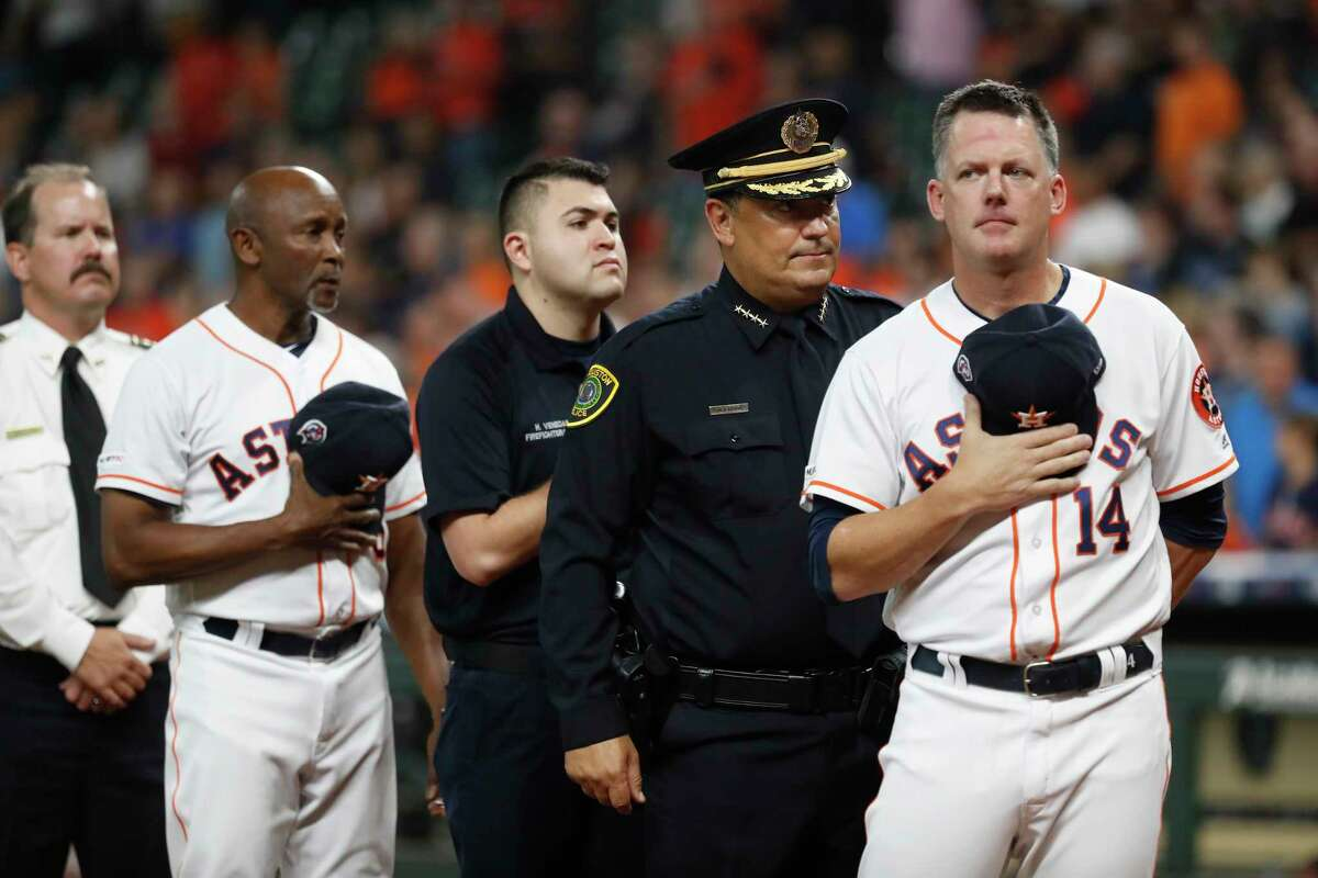 Houston Astros manager AJ Hinch (14) with Houston Police Chief Art Acevedo during the National Anthem before the start of the first inning of a MLB baseball game at Minute Maid Park, Wednesday, Sept. 11, 2019, in Houston.