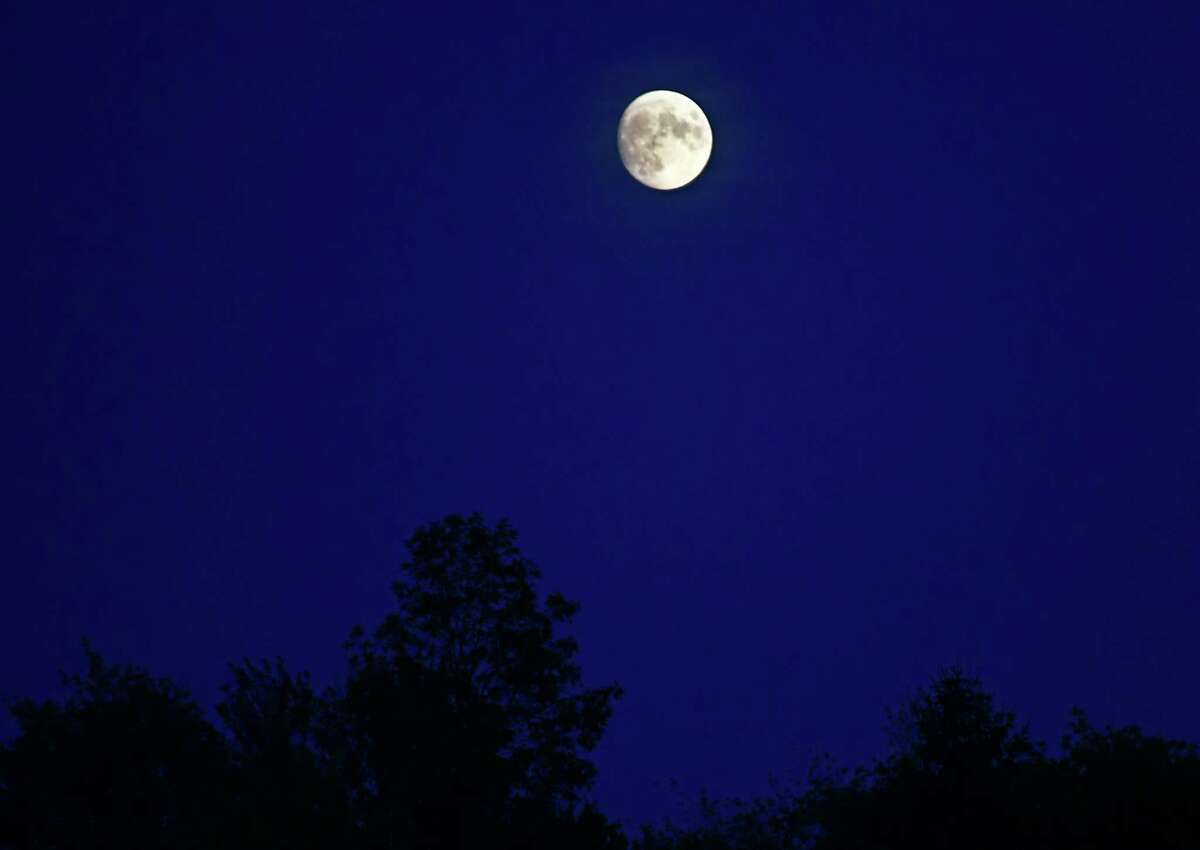 Jason Gough says Friday's clear sky will offer great views of the harvest moon. Things were pretty nice on Wednesday too as moon appeared in the sky above the tree line on Wednesday, Sept. 11, 2019 in Rotterdam N.Y. (Lori Van Buren/Times Union)