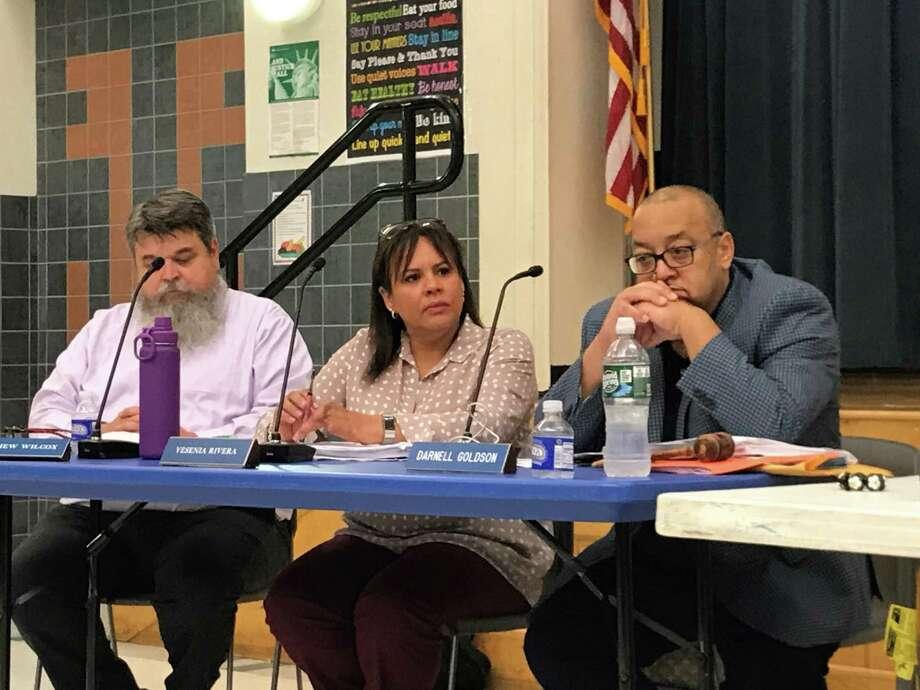 Board of Education members Matt Wilcox, Yesenia Rivera and Darnell Goldson on Sept. 11, 2019. Photo: Brian Zahn / Hearst Connecticut Media