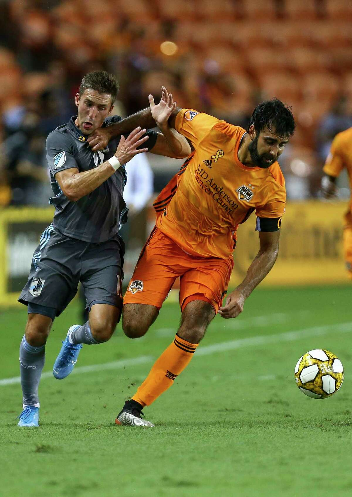 Houston Dynamo defender Kevin Garcia (16) takes the ball away from Minnesota United FC midfielder Ethan Finlay (13) during the first half of an MLS match at BBVA Stadium Wednesday, Sept. 11, 2019, in Houston.