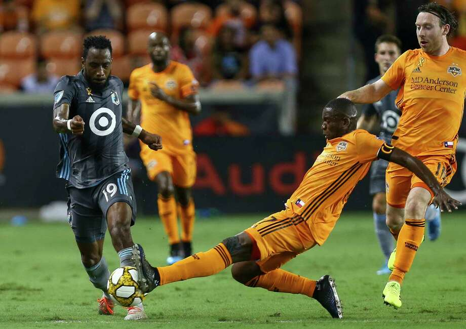 Houston Dynamo midfielder Boniek Garcia (27) pokes the ball away from Minnesota United defender Romain Metanire (19) during the first half of an MLS match at BBVA Stadium Wednesday, Sept. 11, 2019, in Houston. Photo: Godofredo A Vásquez, Staff Photographer / © 2019 Houston Chronicle