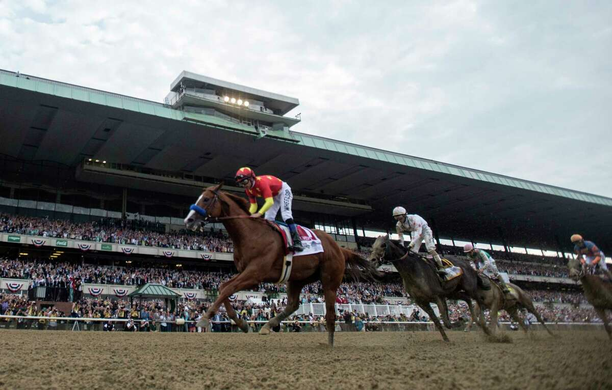 Justify with jockey Mike Smith wins the 150th running of the Belmont Stakes and the coveted Triple Crown of Thoroughbred race at Belmont Park Saturday June 9, 2018, in Elmont, N.Y. Belmont is usually the spot for joyful celebrations of Triple Crown win but this year's race will go first rather than last for the nation's best 3-year-old thoroughbreds. (Skip Dickstein/Times Union)