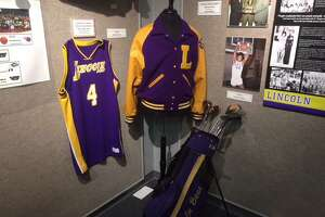 Port Arthur Lincoln sports memorabilia stands on display at the Museum of the Gulf Coast's Hometown Heroes exhibit, which opened on Saturday. Photo by Matt Faye/The Enterprise.