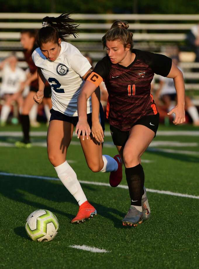 Academy of Holy Names' Samantha Germano, left, and Mohonasen's Alex Skoda battle for the ball during a soccer game on Wednesday, Sept. 11, 2019 in Rotterdam N.Y. (Lori Van Buren/Times Union) Photo: Lori Van Buren / 20047780A