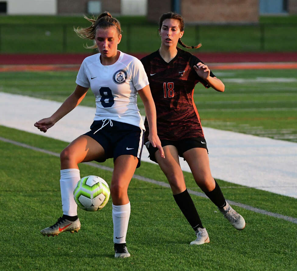 Academy of Holy Names' Elizabeth Harris, left, and Mohonasen's Kyra McCarthy battle for the ball during a soccer game on Wednesday, Sept. 11, 2019 in Rotterdam N.Y. (Lori Van Buren/Times Union)