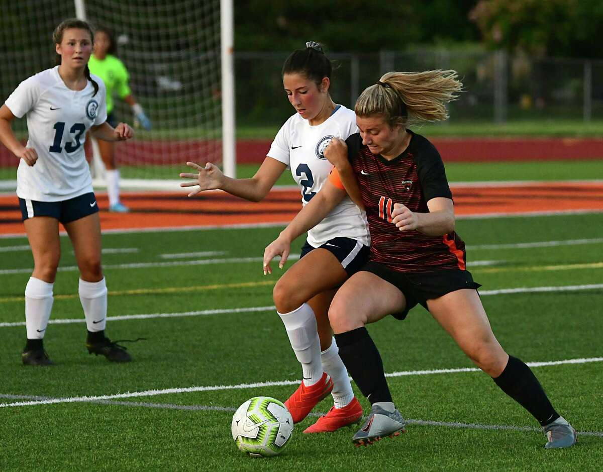 Academy of Holy Names' Samantha Germano, #2, and Mohonasen's Alex Skoda, #11, battle for the ball during a soccer game on Wednesday, Sept. 11, 2019 in Rotterdam N.Y. (Lori Van Buren/Times Union)