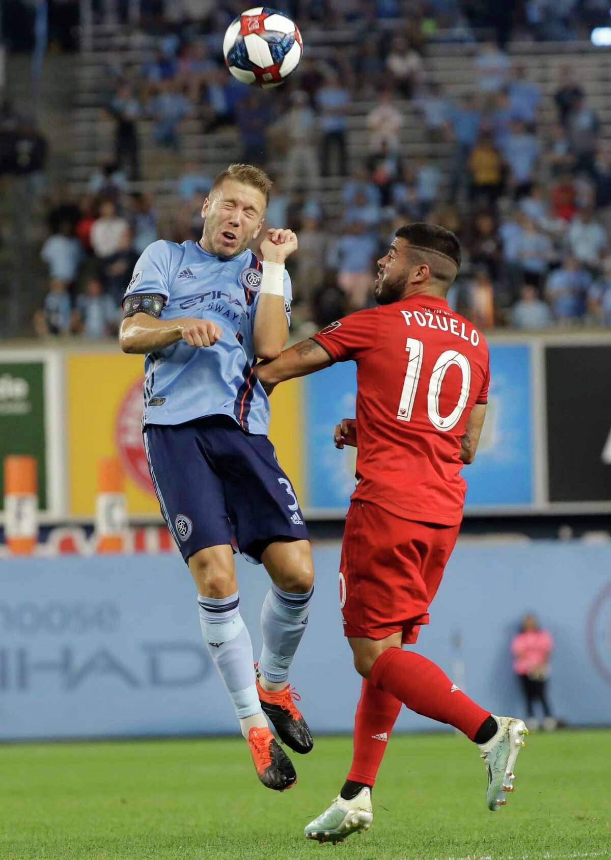 New York City FC's Anton Tinnerholm, left, heads the ball in front of Toronto FC's Alejandro Pozuelo during the first half of an MLS soccer match Wednesday, Sept. 11, 2019, in New York. (AP Photo/Frank Franklin II)