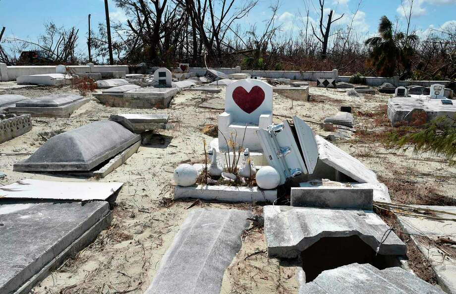 Unearthed graves from the storm surge are seen in East End on Grand Bahama island on September 10, 2019. - Some 2,500 people are unaccounted for in the Bahamas following Hurricane Dorian, the Bahamian National Emergency Management Agency (NEMA) said September 11, 2019. At least 50 people died in the hurricane, which slammed into the northern Bahamas as a Category 5 storm, and officials have said they expect the number to rise significantly. (Photo by Leila MACOR / AFP)LEILA MACOR/AFP/Getty Images Photo: LEILA MACOR / AFP or licensors