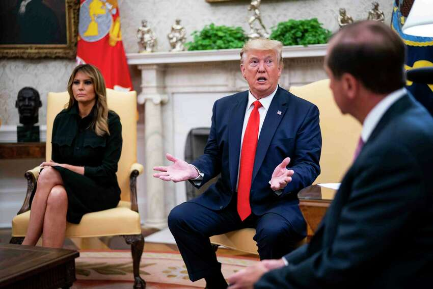 President Donald Trump speaks during a meeting with Alex Azar, right, secretary of health and human services, and first lady Melania Trump in the Oval Office of the White House, in Washington on Wednesday, Sept. 11, 2019. While meeting with top health officials, Trump indicated that his administration was weighing restrictions on the sale of flavored e-cigarettes, at a time when hundreds of people have been sickened by mysterious vaping-related illnesses. (Doug Mills/The New York Times)