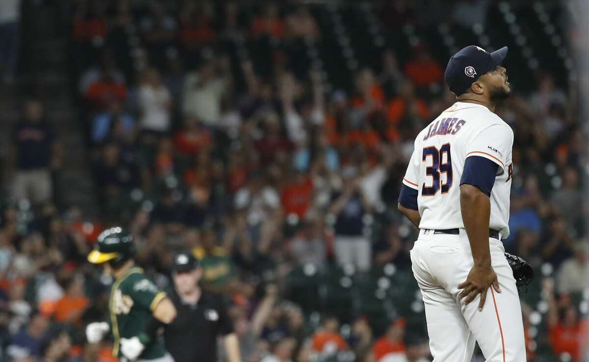 Houston Astros relief pitcher Josh James (39) reacts after giving up a home run to Oakland Athletics Sean Murphy (12) during the sixth inning of a MLB baseball game at Minute Maid Park, Wednesday, Sept. 11, 2019, in Houston.