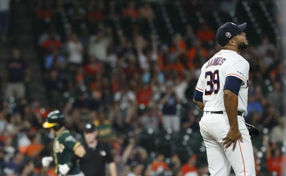 Houston Astros relief pitcher Josh James (39) reacts after giving up a home run to Oakland Athletics Sean Murphy (12) during the sixth inning of a MLB baseball game at Minute Maid Park, Wednesday, Sept. 11, 2019, in Houston. Photo: Karen Warren/Staff Photographer