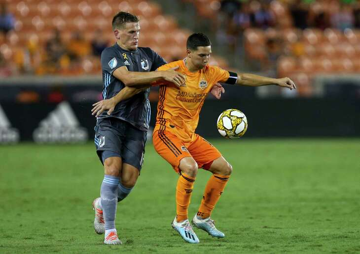 Minnesota United's Robin Led, left, and the Dynamo's Tomas Martinez battle for possession of the ball during the second half.