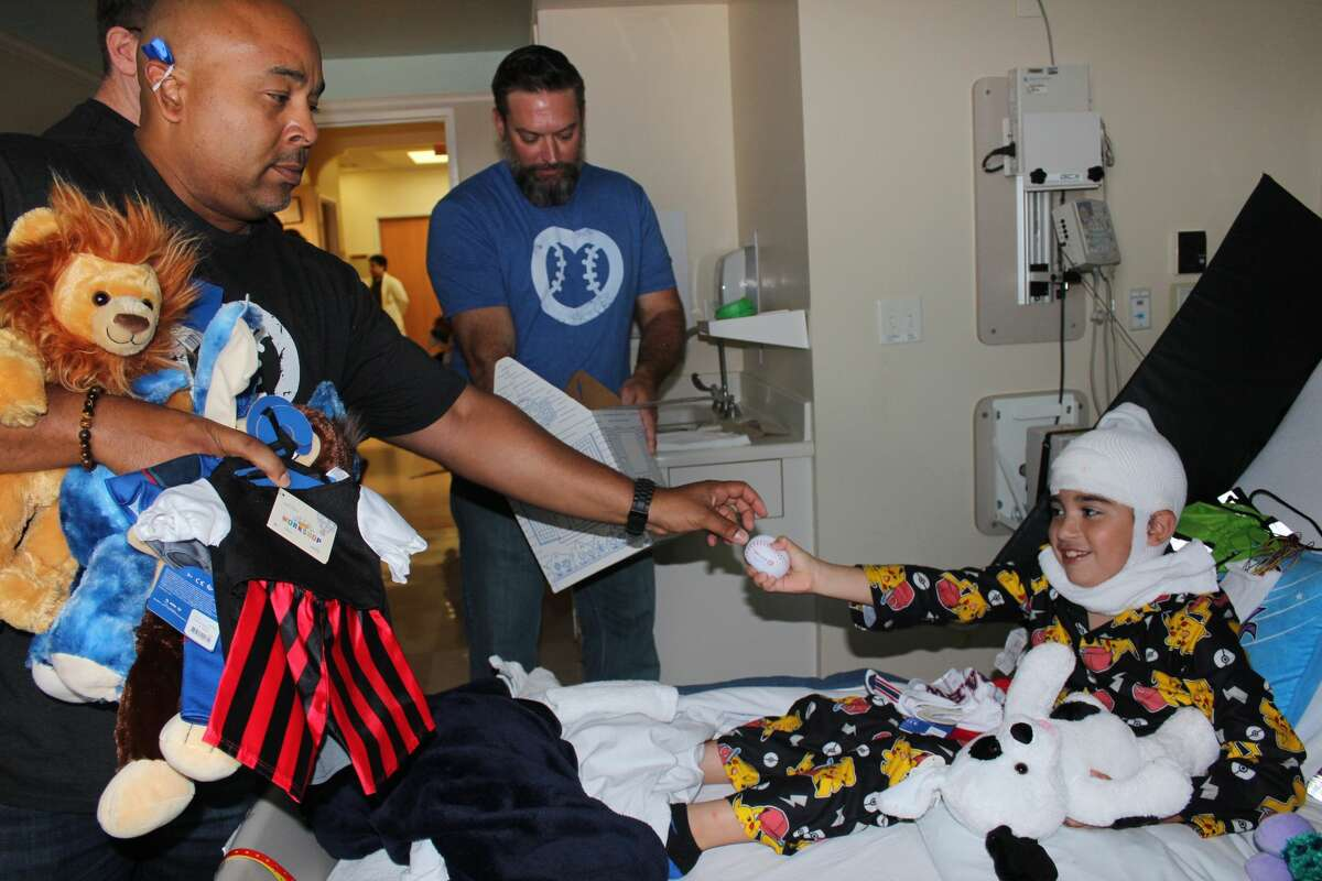 MLB umpire and Houston native Adrian Johnson and crew members visit young patients at Memorial Hermann Children's Hospital.