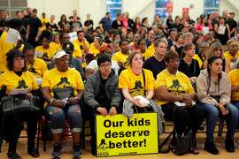 Opponents to the proposed school mergers listend to the board during an Oakland Unified School District meeting where the proposals to merge several elementary schools were discussed at La Escuelita Education Center in Oakland, Calif., on Wednesday, September 11, 2019.