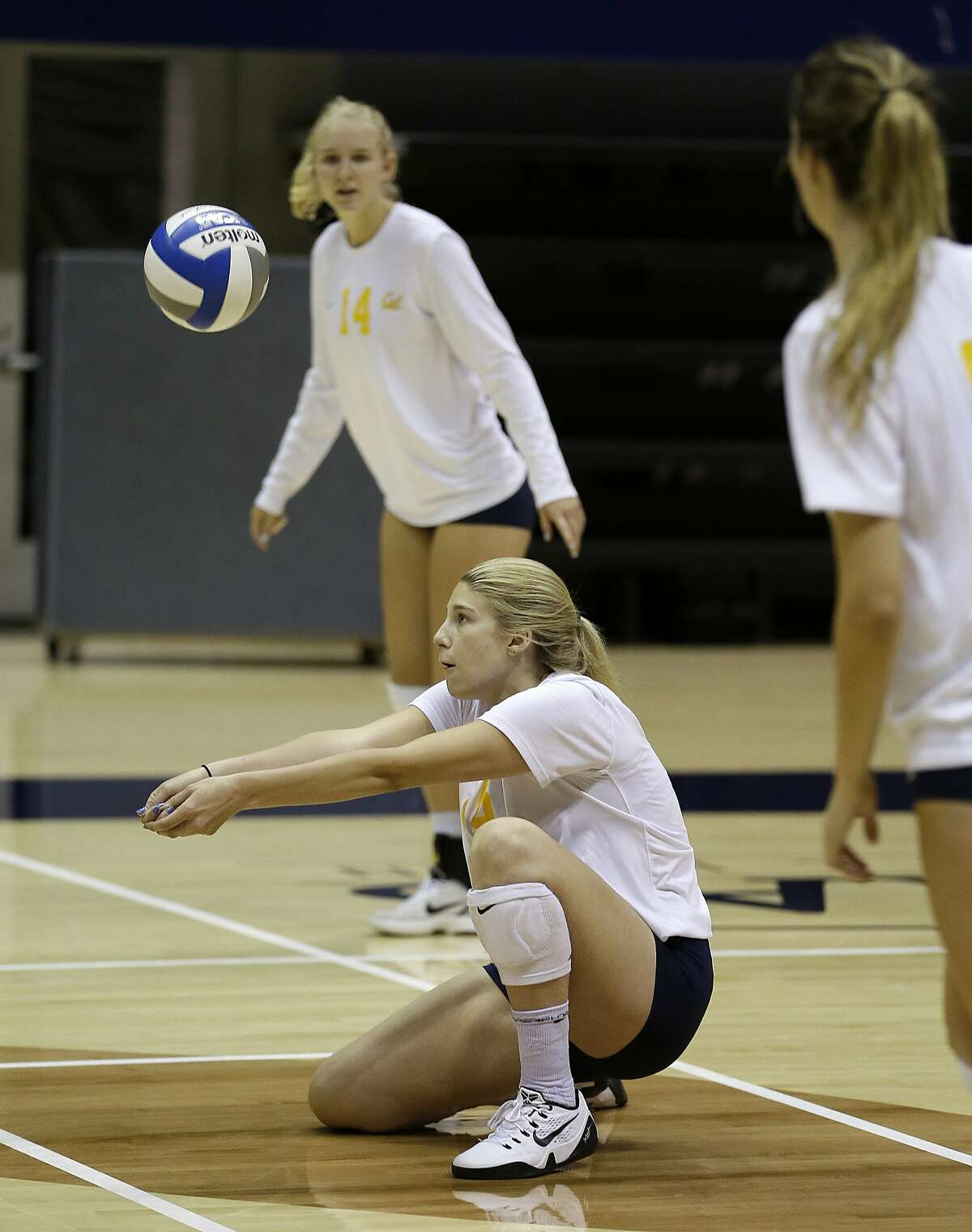 In this photo taken Tuesday, Aug. 30, 2016, Savannah Rennie, who underwent a liver transplant, sets up the ball during volleyball practice at the University of California, Berkeley in Berkeley, Calif. Rennie returned to Cal early in August following five months in Indiana, where she received a crucial liver transplant that has allowed her slowly, somewhat impatiently to get back on the volleyball court for the Golden Bears. And she might even get in a match again by season's end, though nobody's rushing that process but Rennie herself. (AP Photo/Eric Risberg)