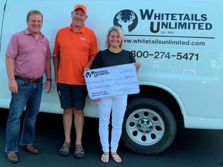From left, Camp Fish Tales Board Member Karl Ieuter, Jason Maraskine of Whitetails Unlimited, and Camp Fish Tales Executive Director Shannon Forshee pose for a photo with a $1,000 grant from Whitetails, to go toward improving the camp's archery program. (Provided photo)