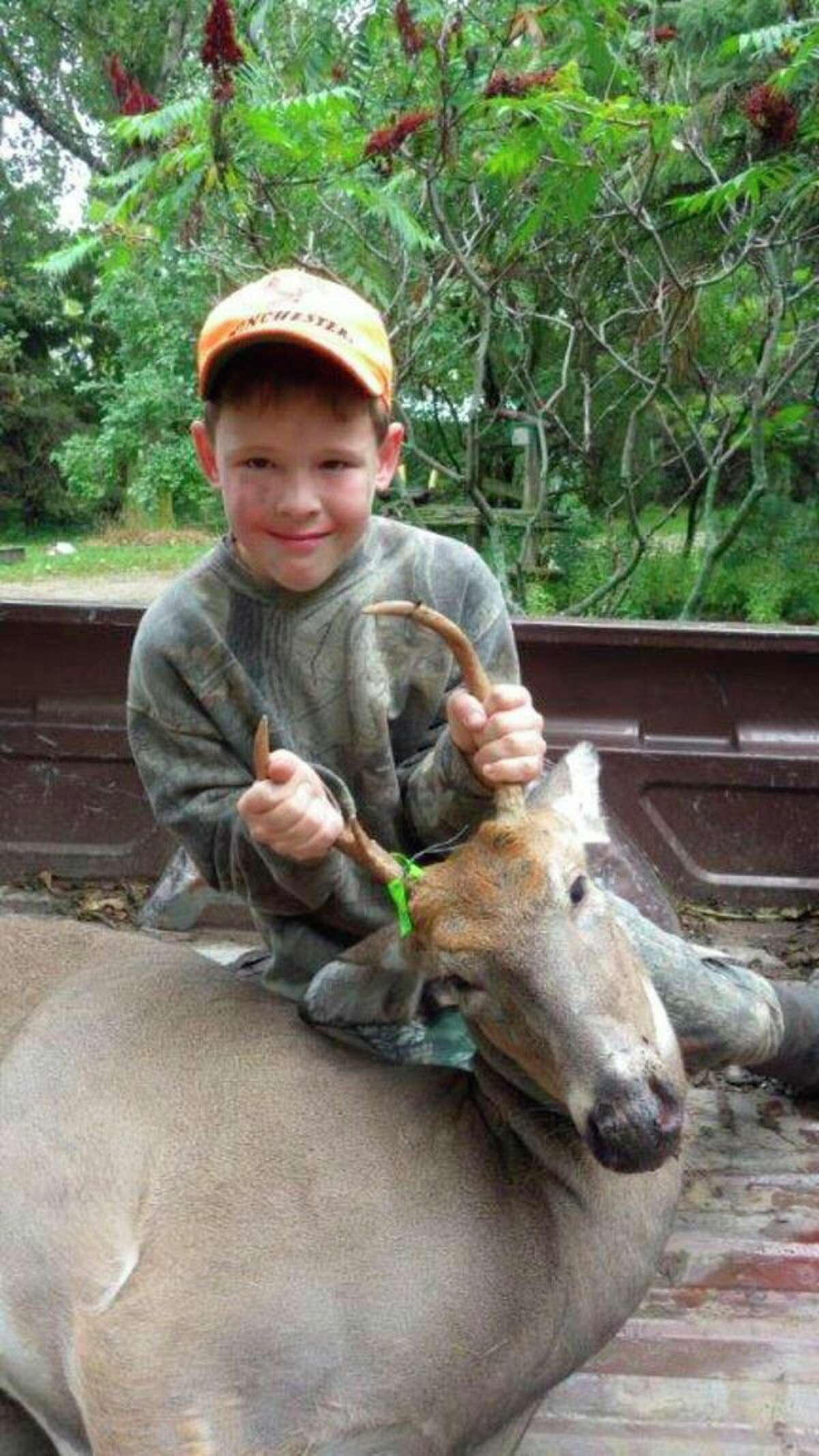 Hugh Walker of Cass City was only 10 years old when he bagged his firstbuck with a .50 caliber muzzleloader during the 2014 Youth Deer Season.His mentor was his Grandpa Bob Walker ofKingston. Hugh remains an avid deer hunter to this day. (Tom Lounsbury/Hearst Michigan)