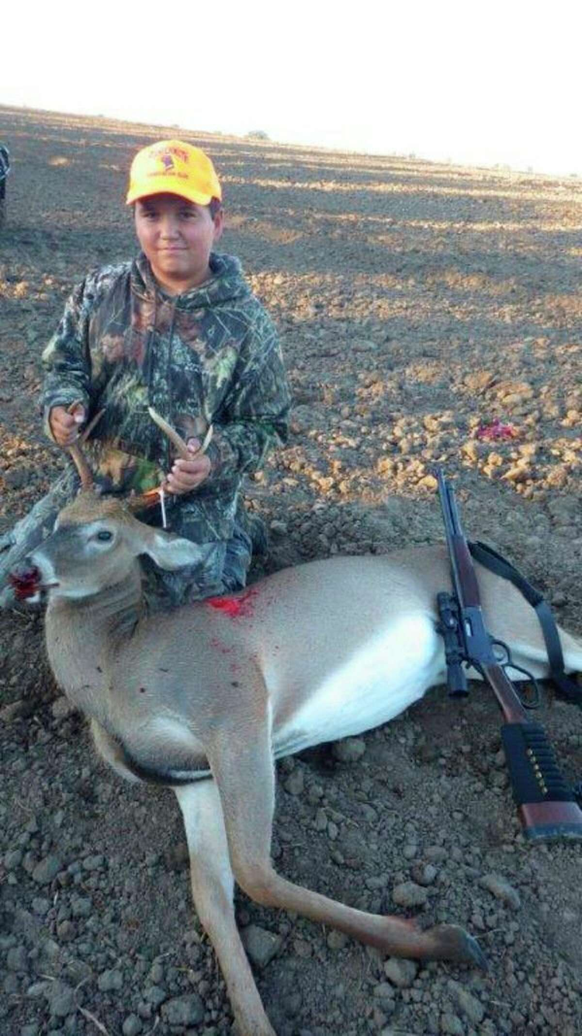 A proud 14-year-old Dale Skinner of Akronshows his first buck, a 2.5-year-old forkhorn taken during the 2018 Liberty Hunt, using a .44 Magnum HenryCarbine.His mentor/guide was Tom Lounsbury. (Tom Lounsbury/Hearst Michigan)