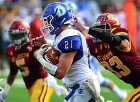Darien's Will Kirby carries the ball as St. Joseph's Michael Morrissey tries tackle during high school football action in Trumbull, Conn., on Saturday Sept. 22, 2018.