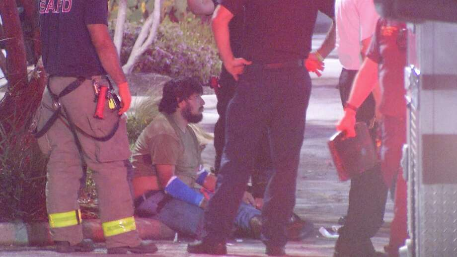 Police investigate men dropped off at mall with gunshot wounds. Photo: Ken Branca