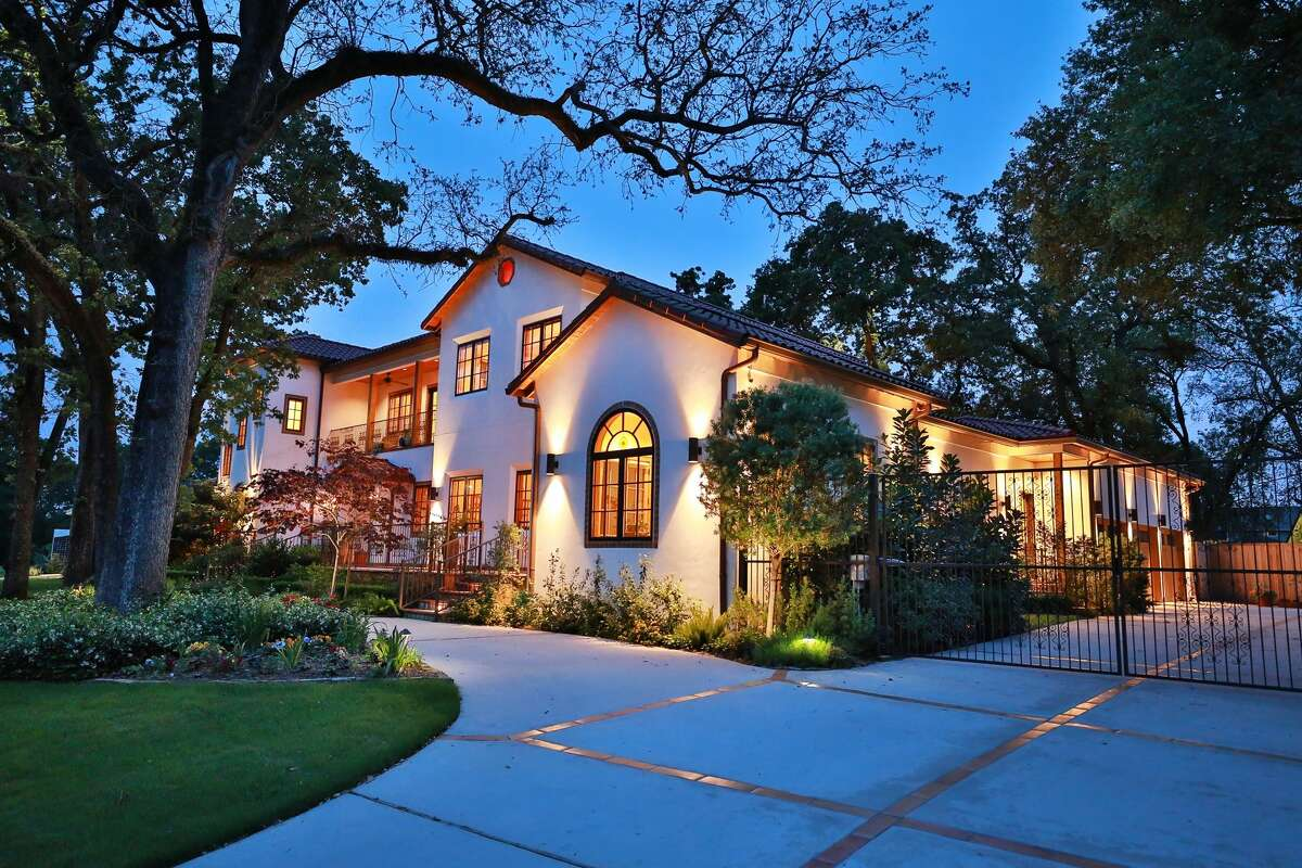 Live in Spanish-Colonial style in this ultra-chic modern 6,008-square foot hacienda home in the much sought after Timbergrove Manor neighborhood that sits just west of the Heights. The home rests on a 17,799-square feet lot and comes complete with two indoor fireplaces and an outdoor fireplace on the loggia. Custom tiled arches, antique doors from Puebla, Mexico and inlaid tiles from Dolores-Hidalgo, Mexico, this home will leave you feeling like you're living on a resort right in the heart of Houston. The home is fully equipped with convenient modern touches, such as surround sound system, speakers in each room, mood lighting and an auto mosquito misting system.