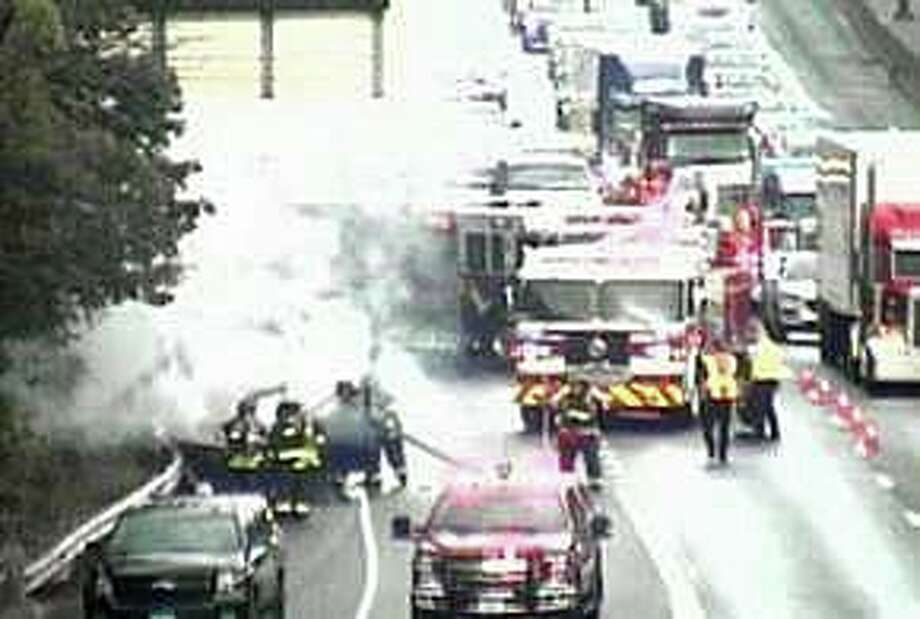 A vehicle fire on northbound I-95 in Fairfield has closed the right lane on Thursday, Sept. 12, 2019. The fire, reported at 8:05 a.m., has closed the lane between Exits 22 and 23. Photo: ConnDOT