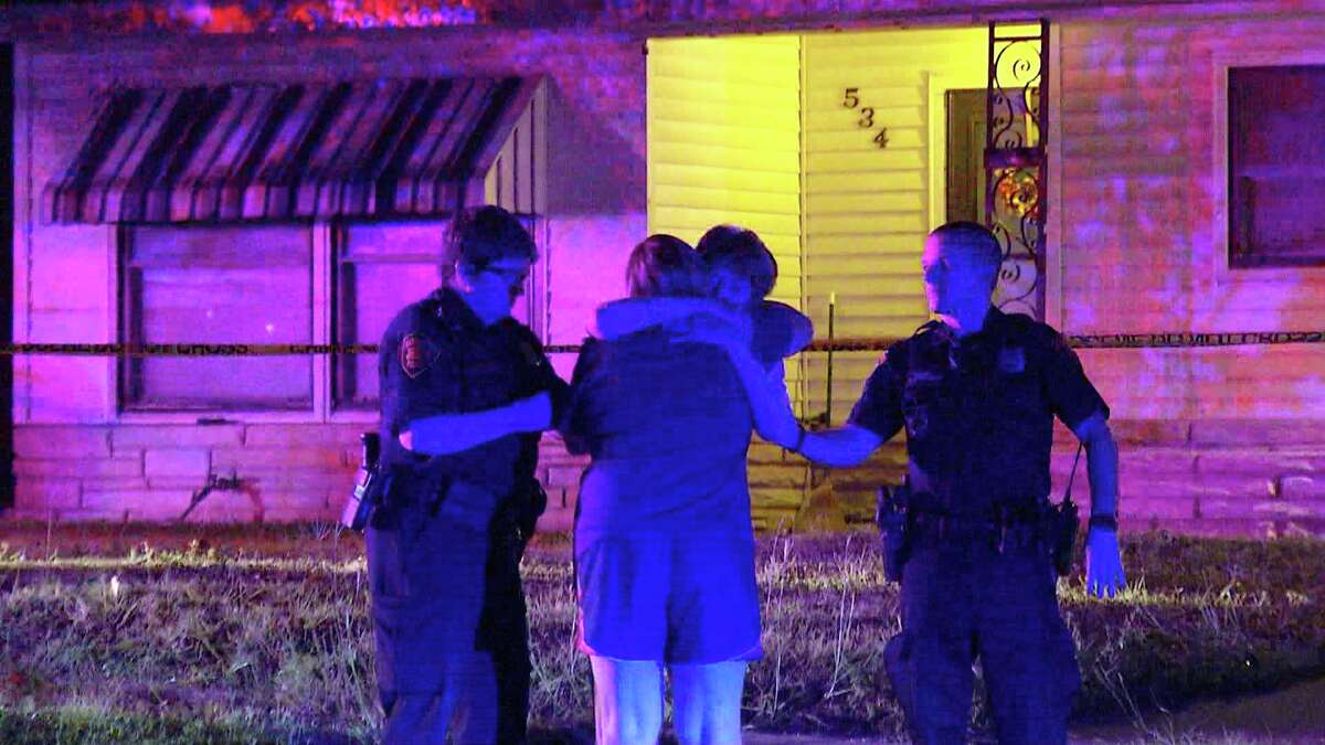 Police investigate a female shot dead inside a North side residence.