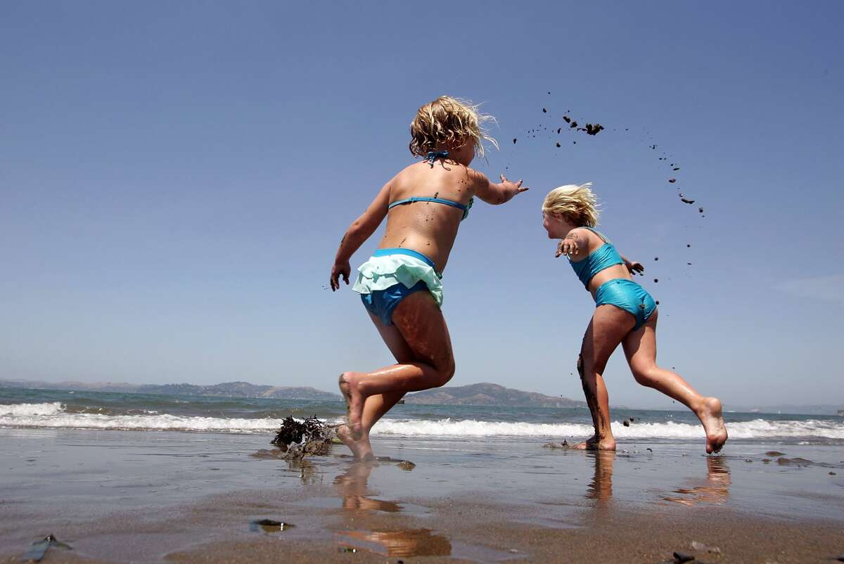 Two young girls play in the water at Crissy Fields July 18, 2006 in San Francisco, California. Temperatures are forecasted to be near 80 degrees in San Francisco and up to over 100 in the inland areas of the Bay Area as the nation cotinues to go through a heat wave.