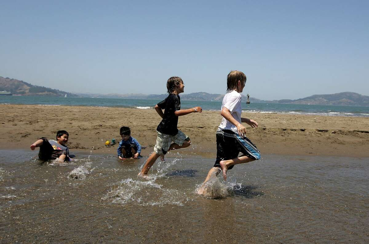 FILE: Two young boys play in the water at Crissy Fields July 18, 2006 in San Francisco. Temperatures are forecasted to be near 80 degrees in San Francisco and up to over 100 in the inland areas of the Bay Area as the nation continues to go through a heat wave.