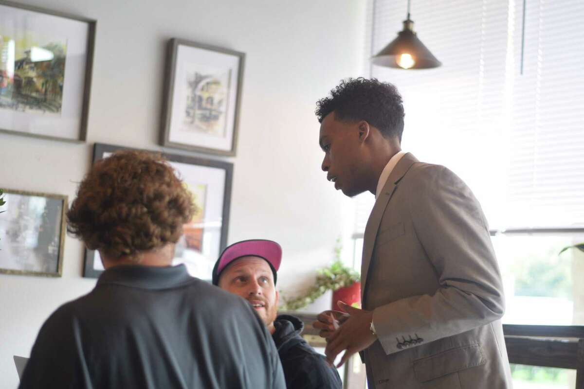 Ryan C. Irving, Jr., candidate for theCy-Fair ISD board of trustees, speaks with members of the community in The Cuppo Coffee and Tea on Sept. 11, 2019.