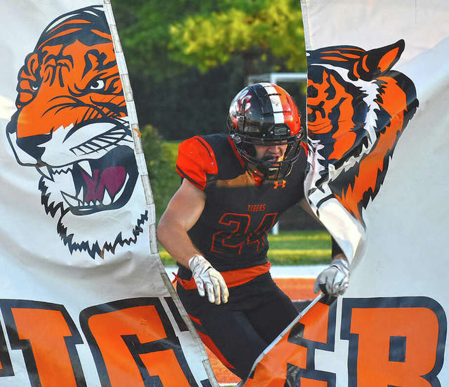 EHS linebacker Jacob Morrissey breaks through a banner during the pregame for Week 2 against CBC.